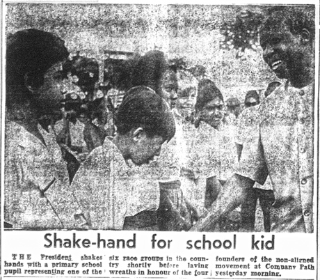 Shaking Julius Nyerere's hand while representing one of the six nations of Guyana. Guyana Graphic, Sept. 14, 1974